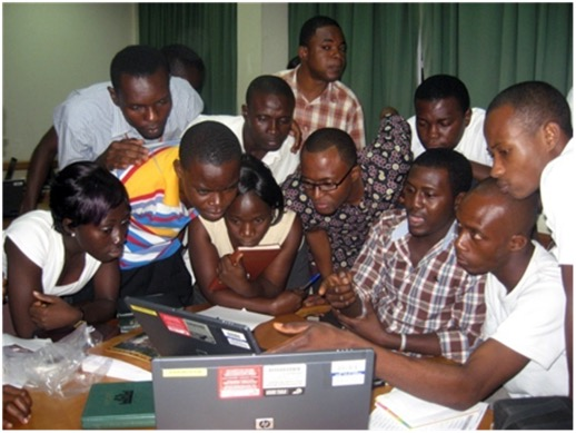 many students around computer